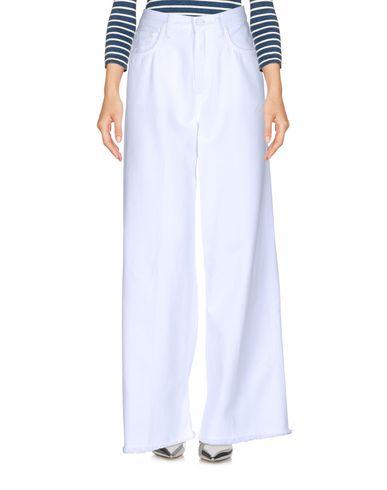 Купить Джинсовые брюки от TOMBOY белого цвета