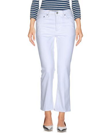 Фото - Джинсовые брюки белого цвета