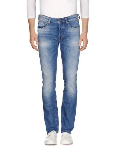 Фото - Джинсовые брюки от UNIFORM синего цвета
