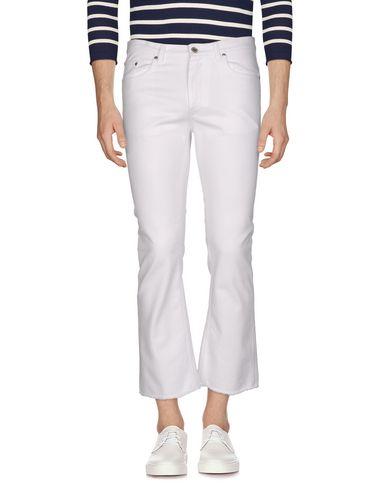 Фото - Джинсовые брюки от MSGM белого цвета