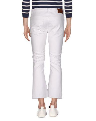 Фото 2 - Джинсовые брюки от MSGM белого цвета