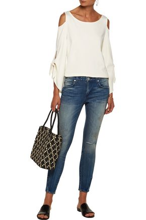 AMO Twist Zip distressed mid-rise slim-leg jeans