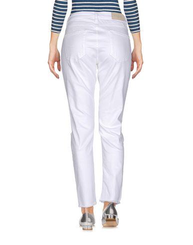 Фото 2 - Джинсовые брюки от GAëLLE Paris белого цвета
