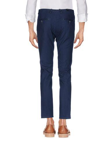 Фото 2 - Повседневные брюки от OBVIOUS BASIC синего цвета