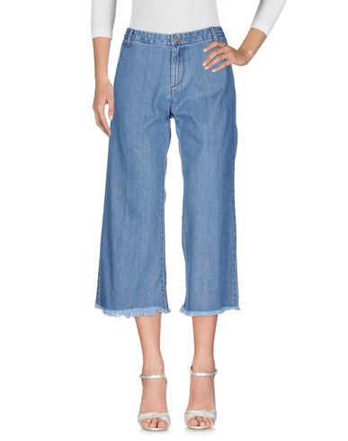 Фото - Джинсовые брюки от P.A.R.O.S.H. синего цвета