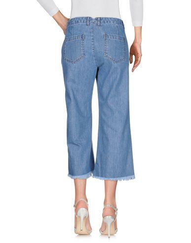 Фото 2 - Джинсовые брюки от P.A.R.O.S.H. синего цвета