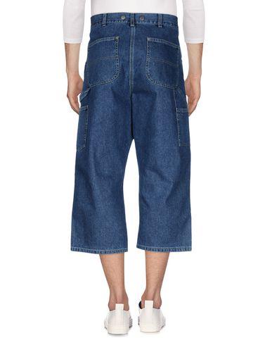 Фото 2 - Джинсовые брюки-капри от PAURA синего цвета