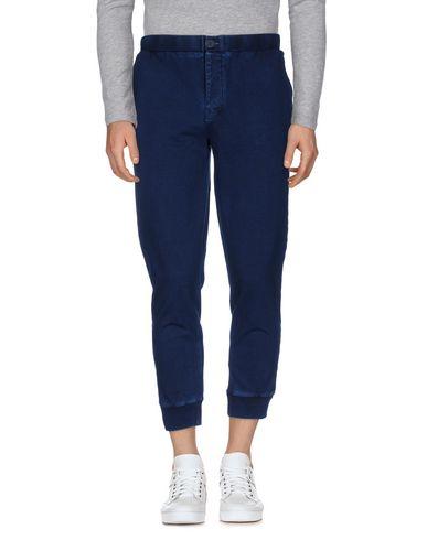 Фото - Повседневные брюки от EDWIN темно-синего цвета