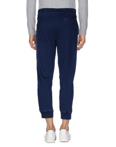 Фото 2 - Повседневные брюки от EDWIN темно-синего цвета