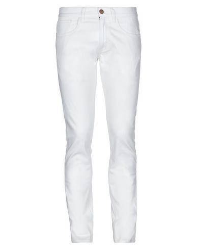 Фото - Джинсовые брюки от SUN 68 белого цвета