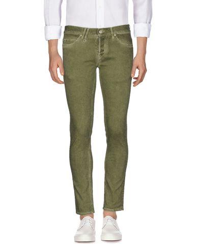 Фото - Джинсовые брюки зеленого цвета