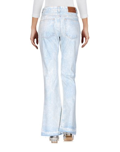 Фото 2 - Джинсовые брюки от MSGM синего цвета