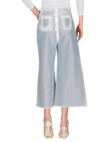 Фото 2 - Джинсовые брюки от AVIÙ синего цвета