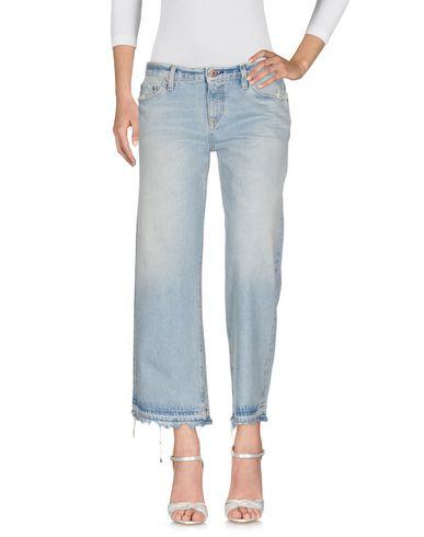 Купить Джинсовые брюки от SIMON MILLER синего цвета