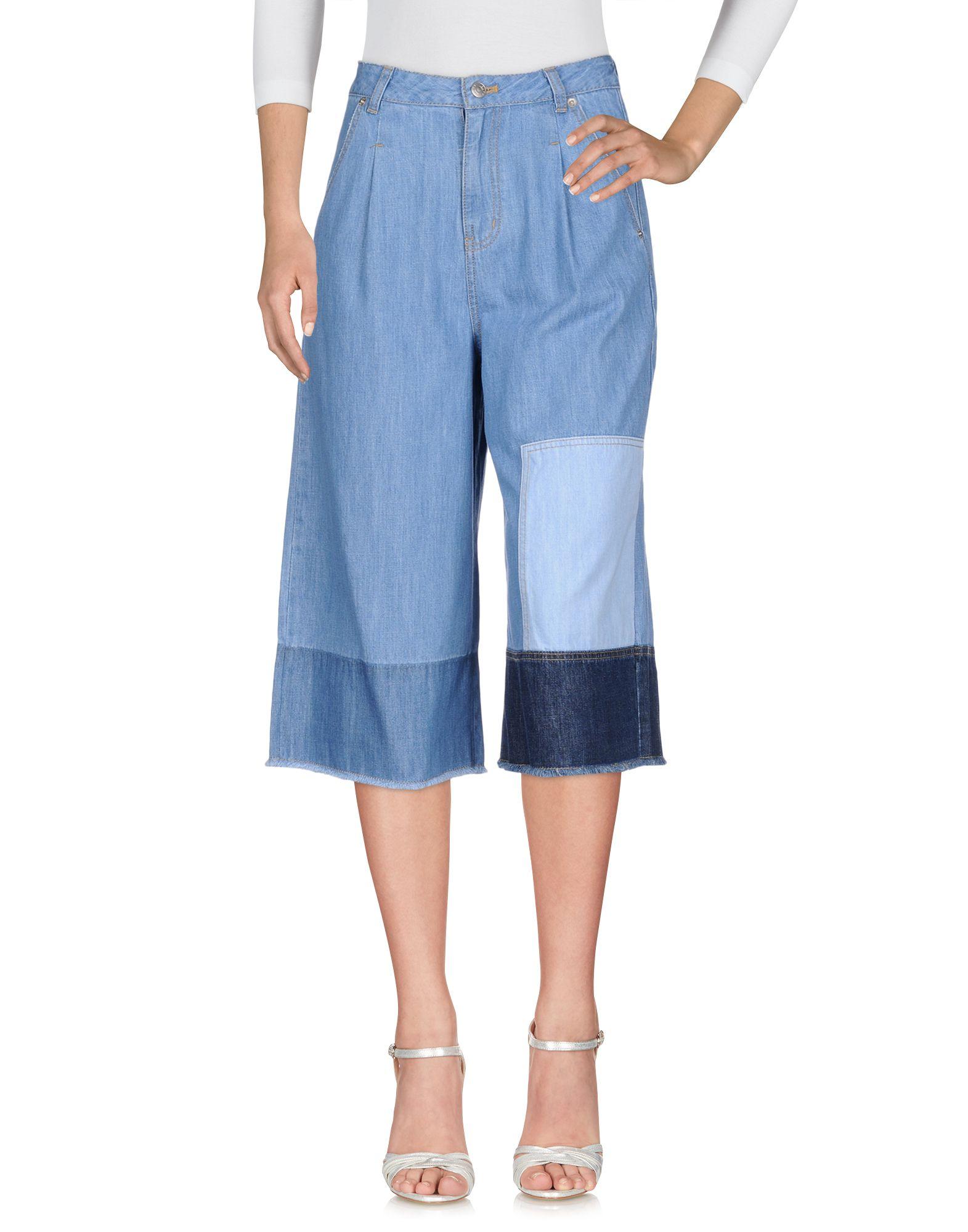 купить SJYP Джинсовые брюки по цене 20000 рублей