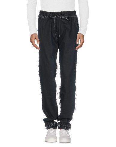 Джинсовые брюки от ANDREA CREWS