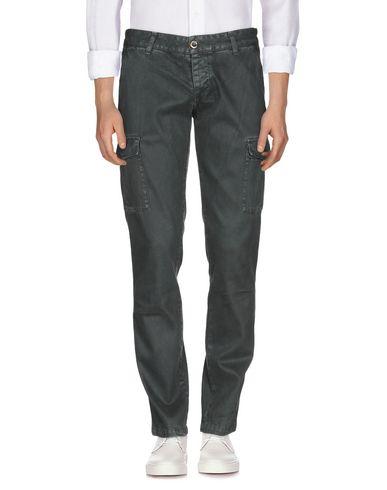 Фото - Джинсовые брюки темно-зеленого цвета