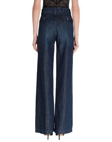 Фото 2 - Джинсовые брюки от BLUE DE BLEU синего цвета
