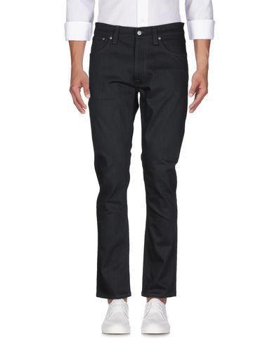 Фото 2 - Джинсовые брюки от NUDIE JEANS CO черного цвета