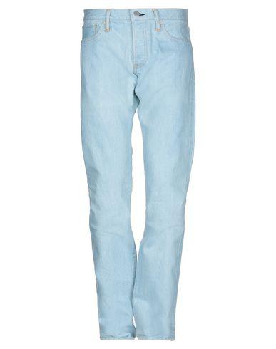 Купить Джинсовые брюки от MAISON KITSUNÉ синего цвета