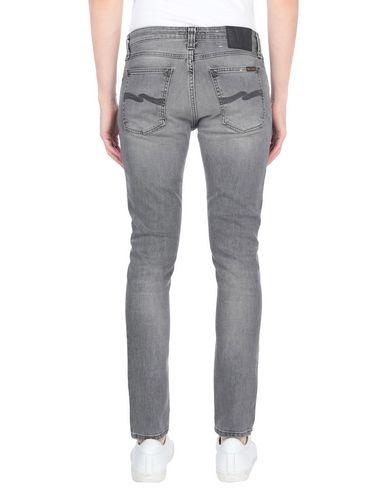 Фото 2 - Джинсовые брюки от NUDIE JEANS CO серого цвета