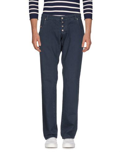 Фото 2 - Джинсовые брюки темно-синего цвета