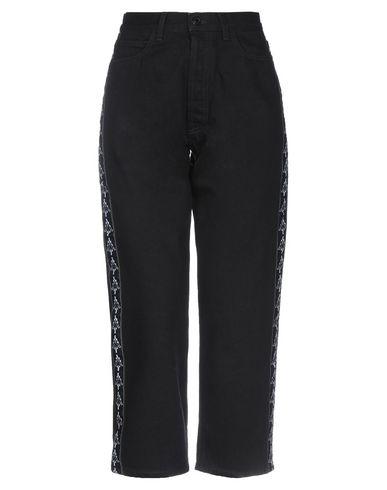 Фото - Джинсовые брюки от MARCELO BURLON x KAPPA черного цвета