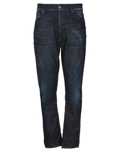 Купить Джинсовые брюки от NUDIE JEANS CO синего цвета
