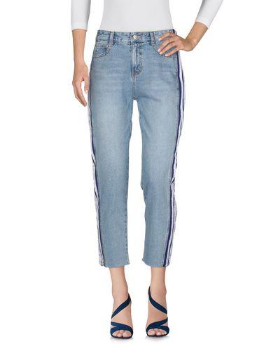 Фото 2 - Джинсовые брюки от SJYP синего цвета