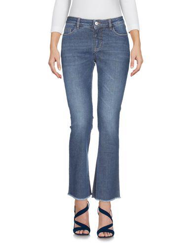 Фото 2 - Джинсовые брюки от NINE:INTHE:MORNING синего цвета