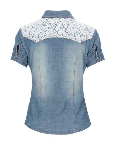Фото 2 - Джинсовая рубашка от KORALLINE синего цвета