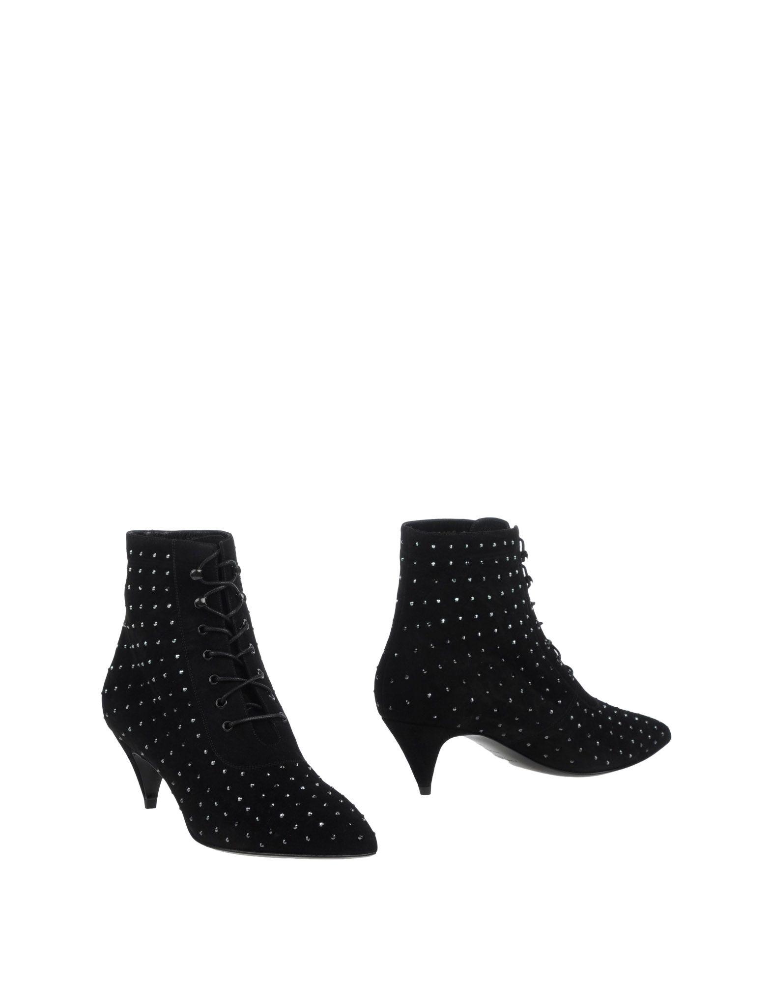цена на SAINT LAURENT Полусапоги и высокие ботинки
