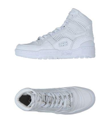 Фото - Высокие кеды и кроссовки от DKNY белого цвета