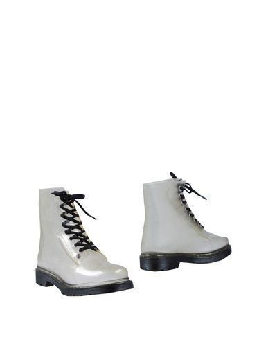 Фото - Полусапоги и высокие ботинки от G•SIX WORKSHOP прозрачного цвета