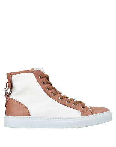 Фото - Высокие кеды и кроссовки от STOKTON желто-коричневого цвета