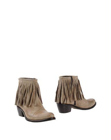 Полусапоги и высокие ботинки от UNLACE