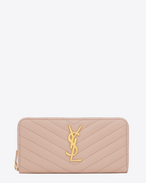 MONOGRAM SAINT LAURENT zip around wallet in pale pink grain de poudre matelassé textured leather