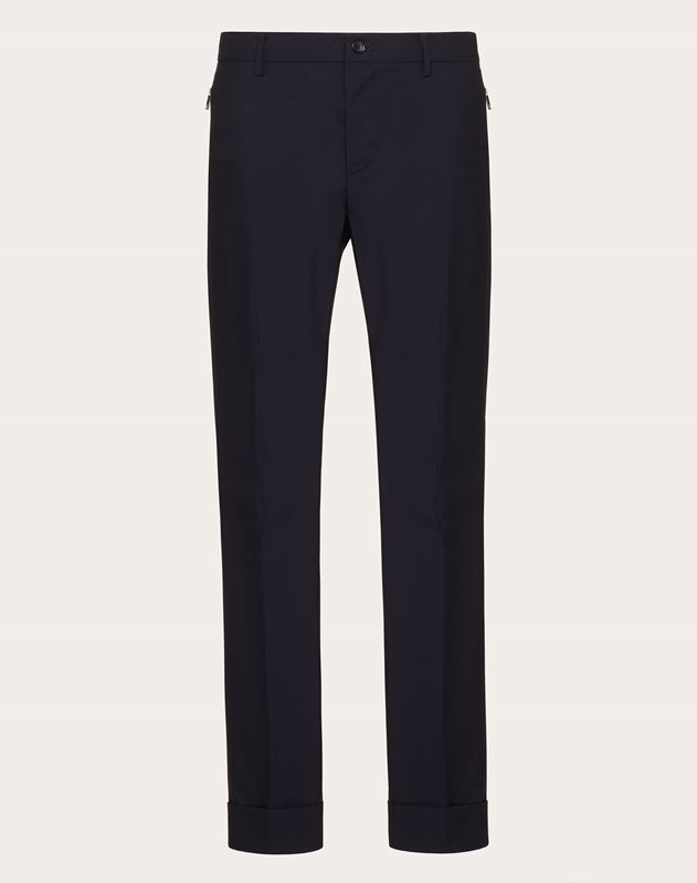 TROUSERS WITH POCKETS AND ZIP FASTENING