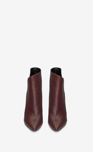 SAINT LAURENT Niki Woman NIKI 105 Asymmetrical Ankle Boot in Light Burgundy Leather b_V4