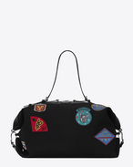 SAINT LAURENT ID bags U Bag Large ID Convertibile nera in tela e patch multicolore f