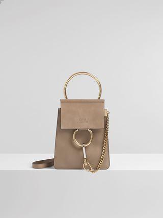 Kleine Faye Armreif-Tasche