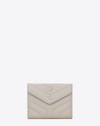 "SAINT LAURENT Monogram Matelassé D LOULOU compact wallet in shiny ivory leather with ""Y"" quilting f"