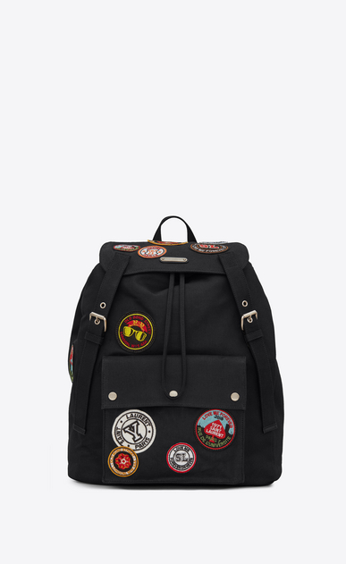 SAINT LAURENT Noé luggages Man NOE SAINT LAURENT backpack with multicolored patches in black gabardine a_V4