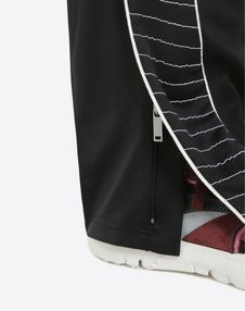 Pants with embroidered bands