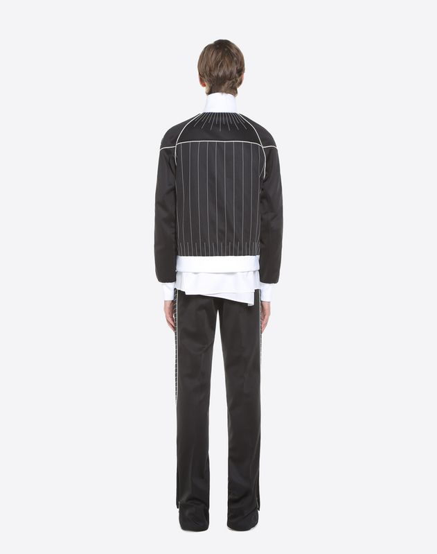 Trousers with embroidered bands