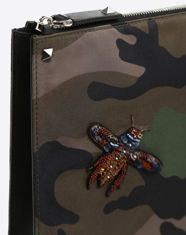 Clutch with insect embroidery