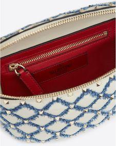 Rockstud Spike belt bag with denim detail
