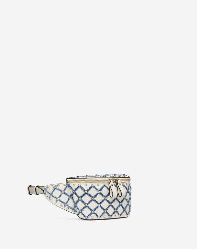 Rockstud Spike belt bag with denim detail
