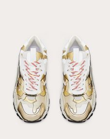 BOUNCE CAMOUFLAGE FABRIC AND METALLIC LEATHER TRAINER
