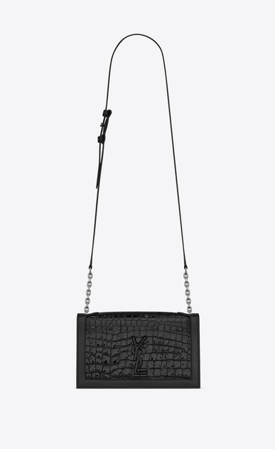 Book bag in crocodile-embossed patent leather